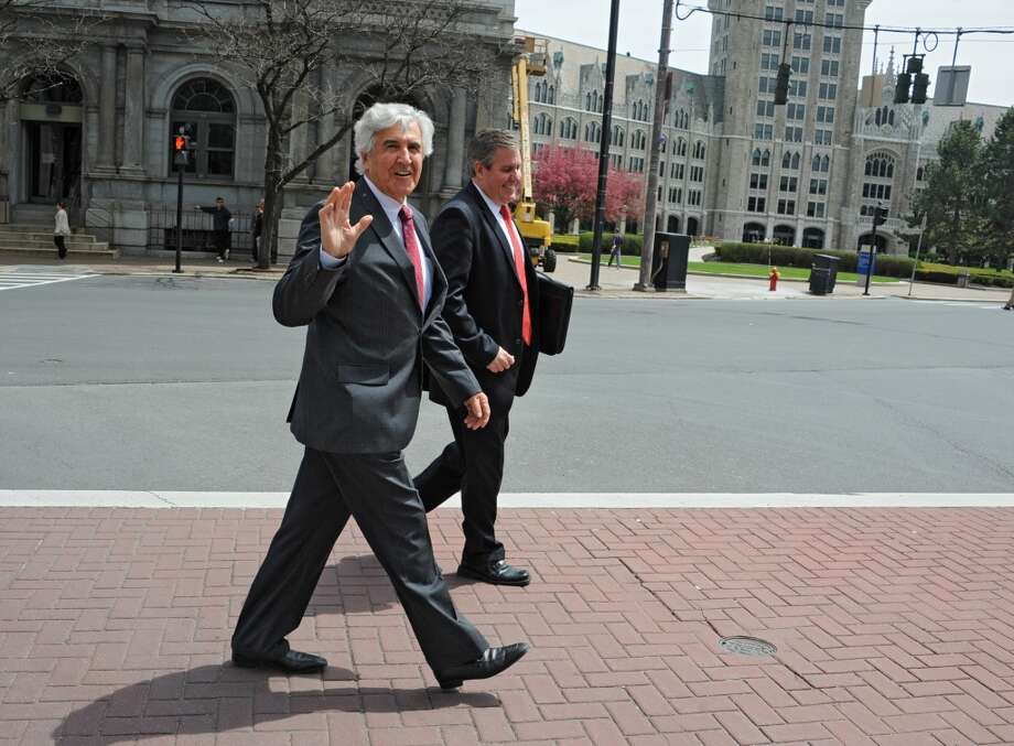 Former state Senate Majority Leader Joseph Bruno, left, leaves the James T. Foley U.S. Courthouse during a lunch break from the resumption of his corruption trial on Wednesday, May 7, 2014 in Albany, N.Y. He is accompanied by his son Kenneth Bruno.  (Lori Van Buren / Times Union) Photo: Albany Times Union
