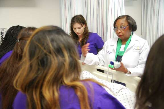 HCC Coleman College for Health Science Nursing faculty member Mary Luckett, MS, RN, leads a first-year nursing class in the college's skill laboratory.