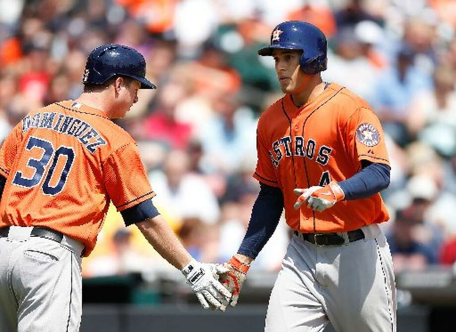 May 8: Astros 6, Tigers 2  George Springer celebrates his fifth inning solo home run with Matt Dominguez. Photo: Gregory Shamus, Getty Images