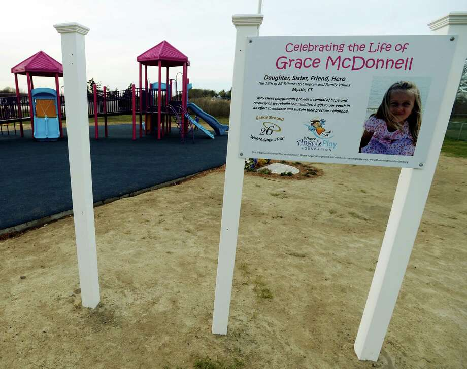 This May 7, 2014 photo shows a gap shows where one of the brand new signs, depicting a peace sign, for the Grace McDonnell playground in Stonington, Conn., was stolen. The playground was constructed and dedicated at the end of April as part of the Sandy Ground Project building 26 playgrounds in memory of each of the victims of the December 2012 Sandy Hook shootings. Photo: TIM MARTIN, AP Photo/The Day, Tim Martin / Associated Press