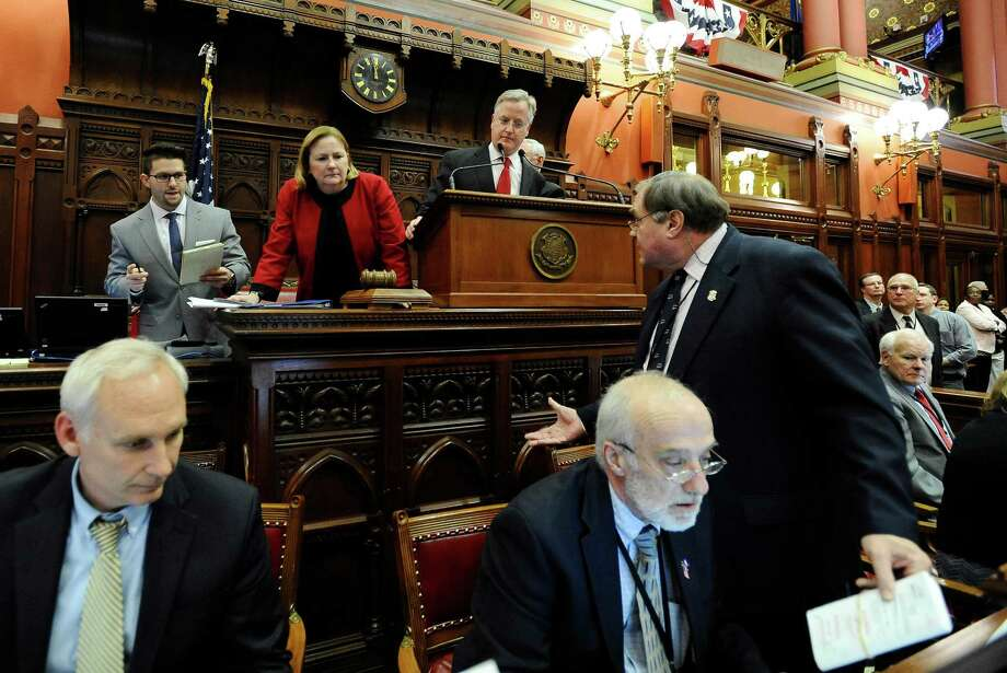 Connecticut Speaker of the House Brendan Sharkey, at podium, looks for assistance after the house electronic tally board malfunctions in the final minutes of session at the Capitol, Wednesday, May 7, 2014, in Hartford, Conn. Photo: Jessica Hill, AP Photo/Jessica Hill / Associated Press