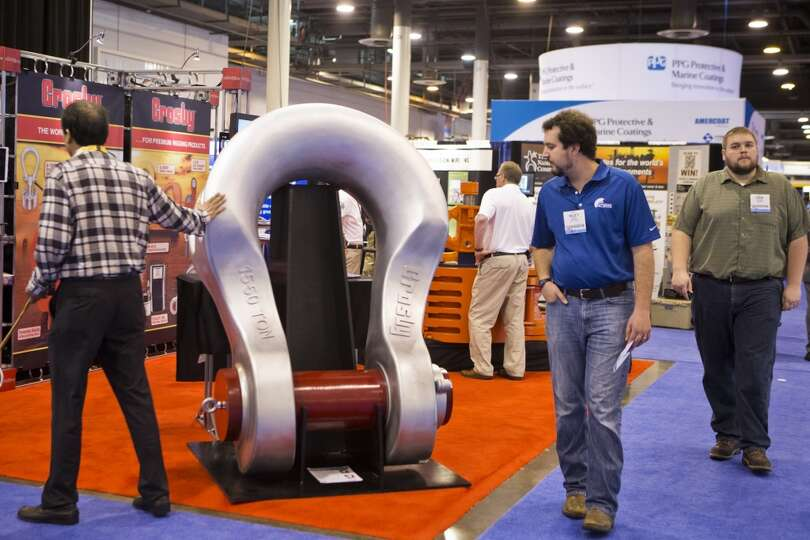 Offshore Technology Conference attendees walked by a giant rig accessory at The Crosby Group booth o