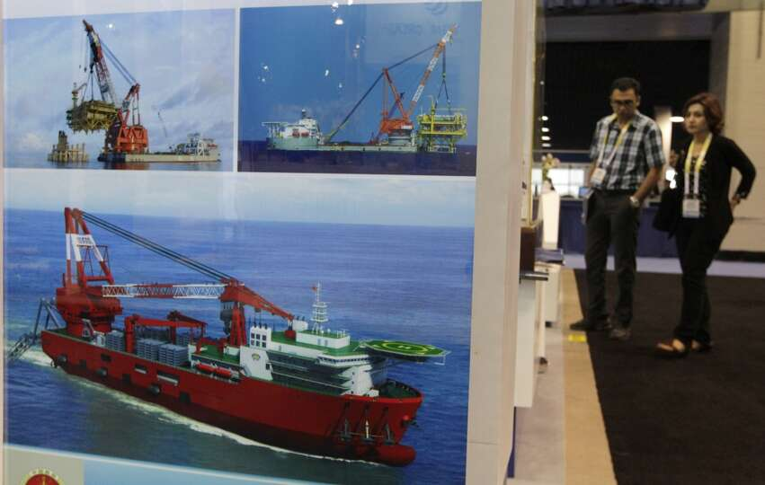 Barges and rigs from the Shanghai Zhenhua Heavy Industries Co. are on display in the NRG Arena durin