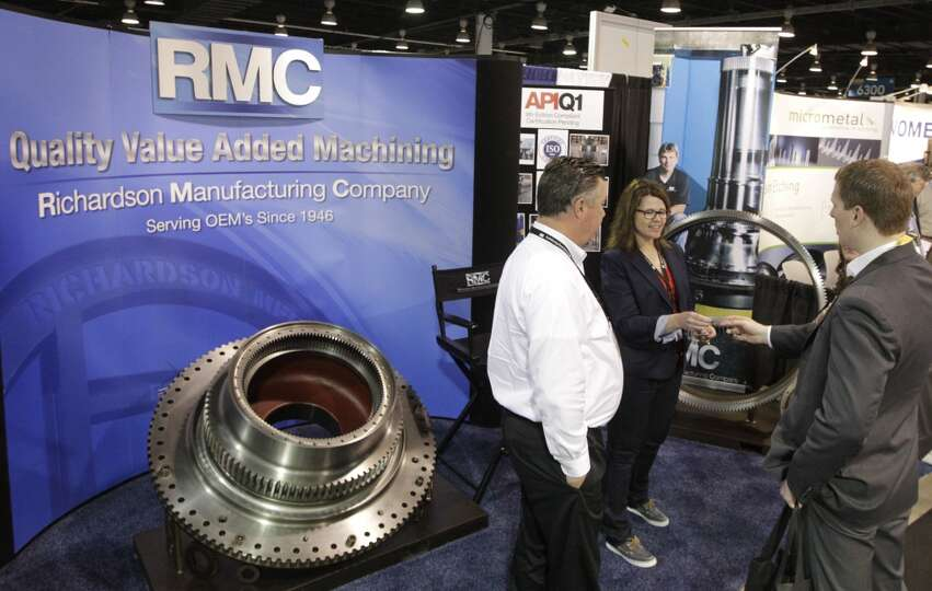 Kara Smith and Craig Hickerson, with Richardson Manufacturing Company, greet guest at their booth in
