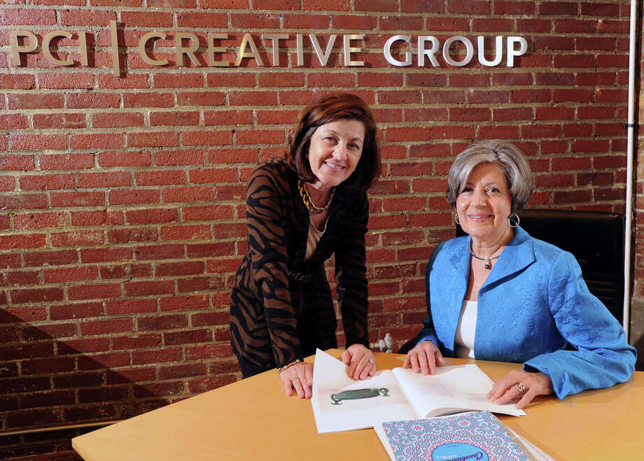 "Anne Chiapetta, left, and her sister, Mary Ferrara, founders and owners of PCI Creative Group, a marketing company, at their business in Stamford, Thursday, May 8, 2014. Gov. Dannel P. Malloy has declared Tuesday, May 13, ""Women Owned Business Day"" in Connecticut. Photo: Bob Luckey / Greenwich Time"