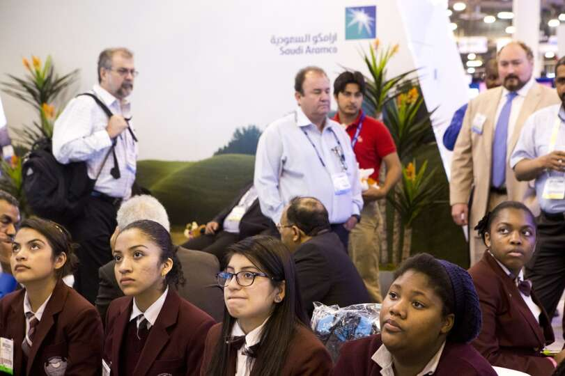 Young Women's College Preparatory Academy students make a stop at the Saudi Aramco booth for a prese