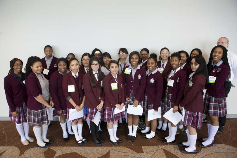 Young Women's College Preparatory Academy students  stand for a group photograph before touring the