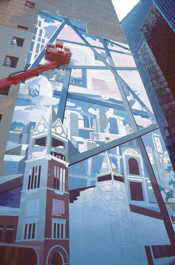 HOUCHRON CAPTION  (05/03/2000): The mural commissioned by Chase Bank of Texas and being painted on the Houston Club Building, Milam and Capitol. Photo: Thomas Nguyen, Special To The Chronicle