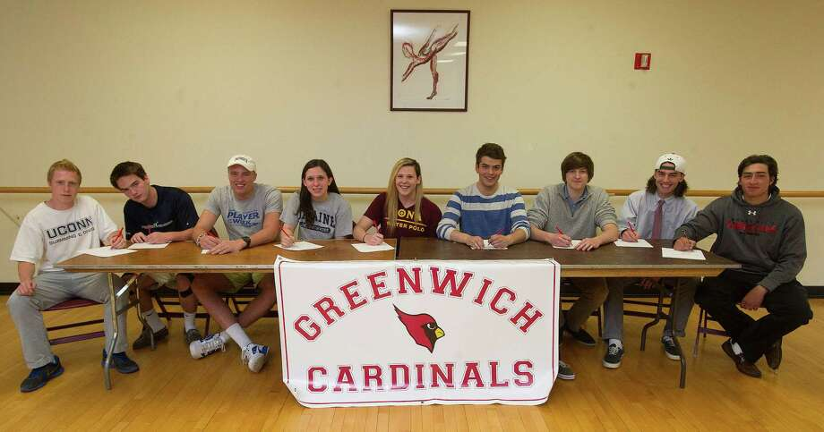 Greenwich High School seniors who have signed National letters of intent pose for a photo on Thursday, May 8, 2014. From left are diver Jeffrey Aselin, UCONN; water polo player John Robinson, Naval Academy; basketball player Alexander Wolf, Dartmouth; swimmer Haley Sylvester, University of Maine; water polo player Paige Neary, IONA; fencer Harrison Tune, Boston College; water polo player Alexander Jahns, Fordham; lacrosse player Kyle Foote, Loyola; golfer Paul Pastore, University of Hartford. Photo: Lindsay Perry / Stamford Advocate
