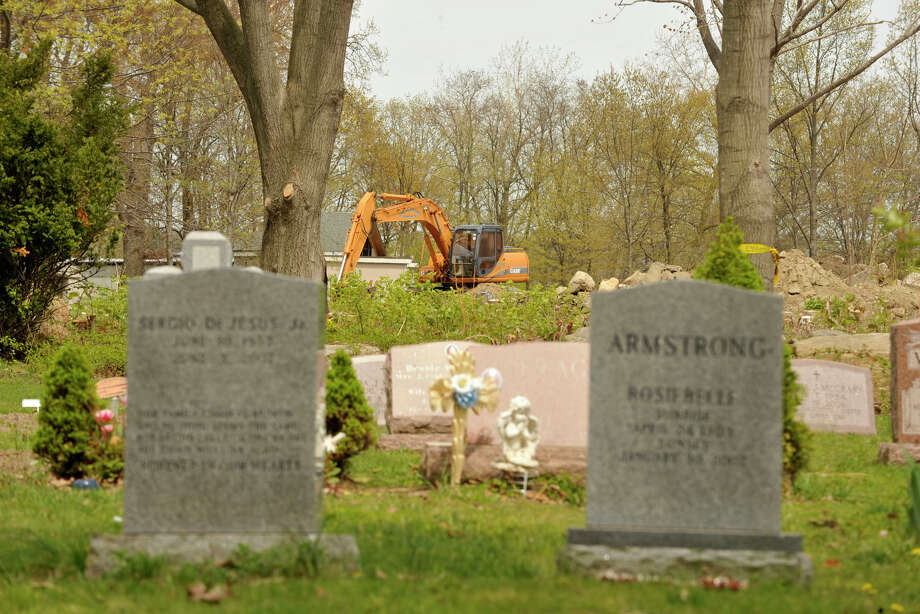 An excavator is seen in the waterfront area of Woodland Cemetery in Stamford, Conn., on Wednesday, May 7, 2014, where a number of trees have been taken down in the past few months. Photo: Jason Rearick / Stamford Advocate