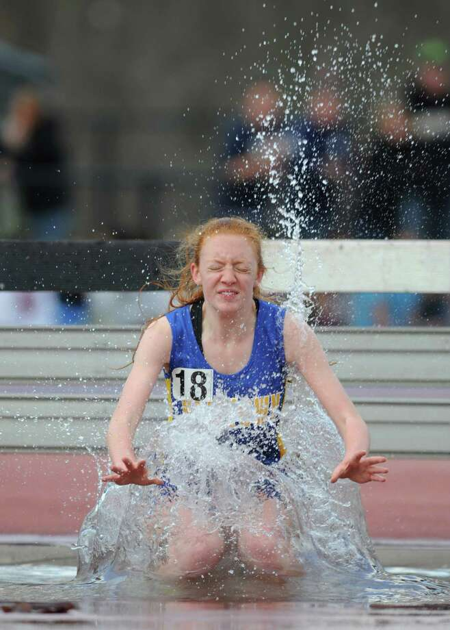 Photos from the 2000 meter steeplechase relay at the 34th annual O'Grady Relays track and field event at Danbury High School in Danbury, Conn. Saturday, April 26, 2014. Photo: Tyler Sizemore / The News-Times