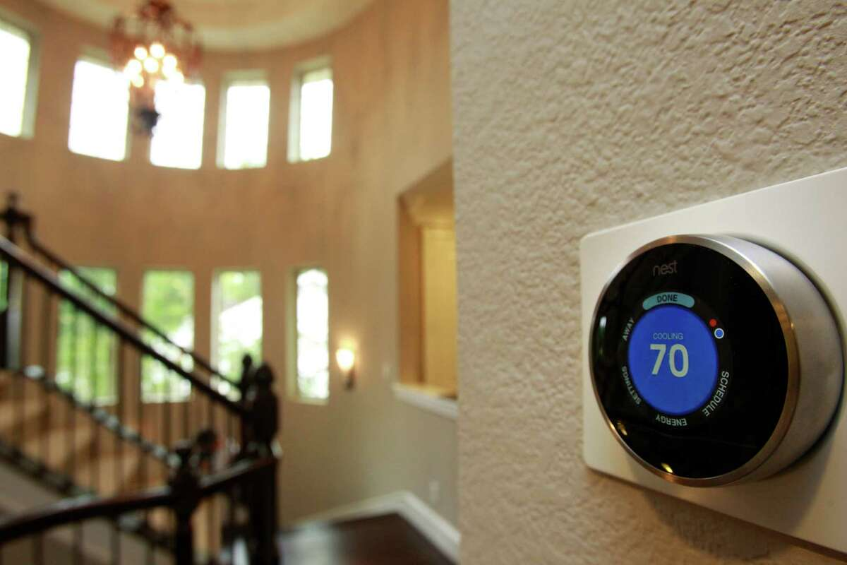 A Nest learning thermostat is shown in a 4,500-square-foot home in the Energy Corridor area that features energy efficient technologies and can operate on or off the grid shown Thursday, May 8, 2014, in Houston. ( Melissa Phillip / Houston Chronicle )