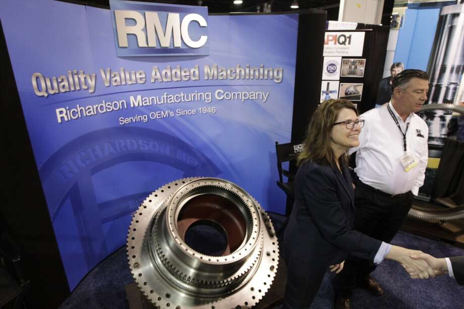 Kara Smith and Craig Hickerson, with Richardson Manufacturing Company, greet guest at their booth in the NRG Arena during the Offshore Technology Conference at NRG Park on Thursday, May 8, 2014, in Houston. ( J. Patric Schneider / For the Chronicle ) Photo: For The Chronicle