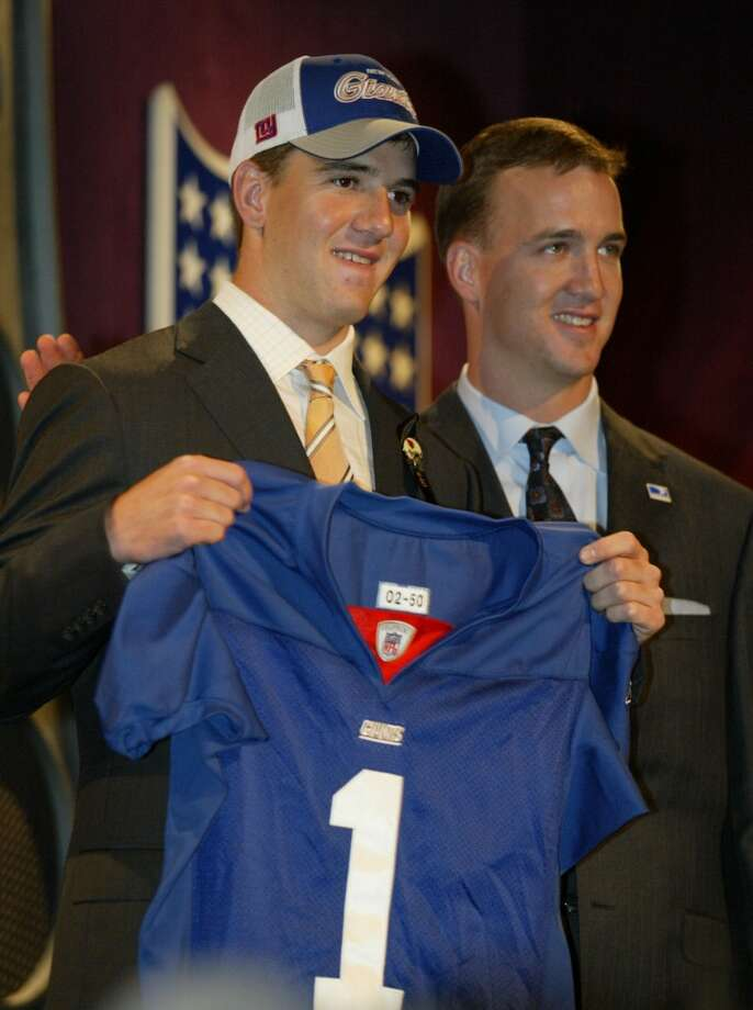 2004  The Chargers drafted Eli Manning, who had said before the fact he didn't want to play in San Diego. So, after the New York Giants selected Philip Rivers with the four pick overall, the teams swapped their rookie quarterbacks with the Chargers getting the Giants first-round selection in 2005 for the trouble. That became the 12th pick and San Diego used it to take linebacker Shawn Merriman, who emerged as one of the league's top players. Manning (pictured with Giants jersey), of course, has won two Super Bowls with the Giants, while Chargers have enjoyed mixed results with Rivers under center. Photo: ED BETZ, Associated Press