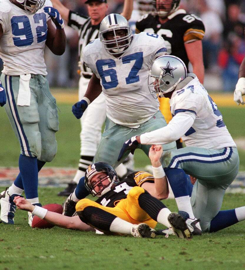 1991  New England wanted to take receiver-return man Raghib Ismail first, but he signed instead with the CFL's Toronto Argonauts. At that point, the Cowboys traded with the Patriots for the No. 1 overall choice thinking they could lure Ismail to Dallas. That failing, they went for nose tackle Russell Maryland (pictured, No. 97) instead. Maryland became a mainstay for the Cowboys during three Super Bowl-winning seasons. To make the trade, the Pats got three veteran players from Dallas and an extra second in addition to the Cowboys' slot in the first round. But it proved to be mostly quantity and minimal quality for New England. Photo: Albert Dickson, Sporting News/Icon SMI