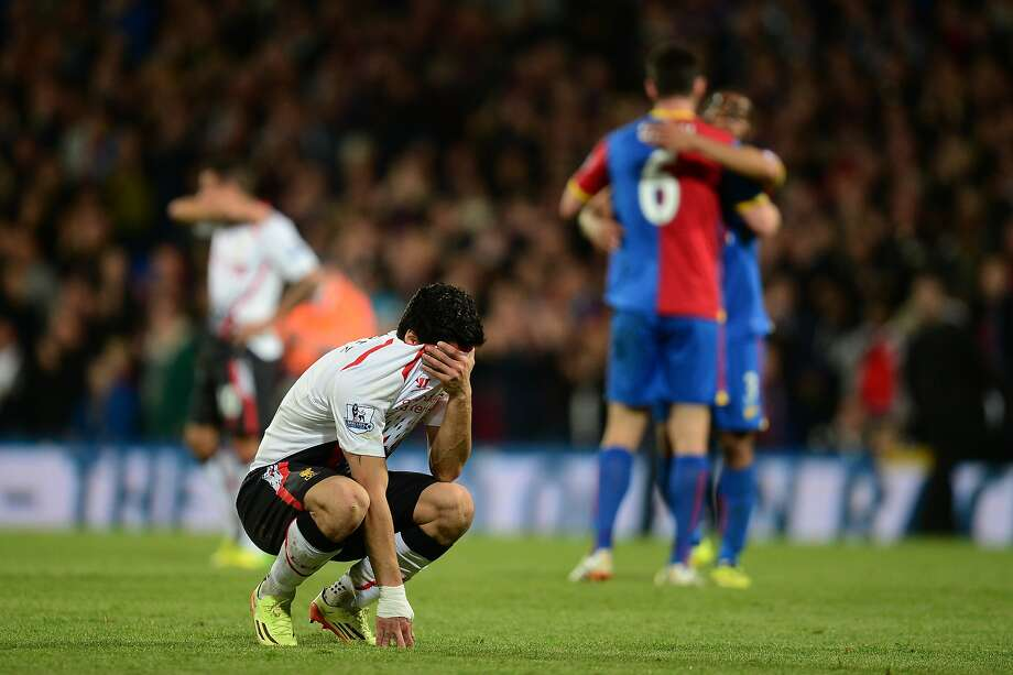 Luis Suarez's emotions took over after Liverpool blew a three- goal lead to imperil its English Premier League title hopes. Photo: Jamie McDonald, Getty Images