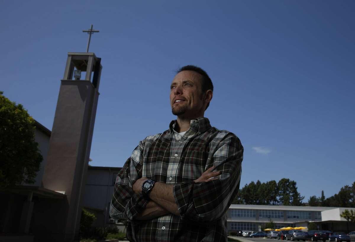 Tim Newman, Bishop O'Dowd High School science department chair, stands near a chapel on campus at Bishop O'Dowd High School on Wednesday, May 7, 2014 in Oakland, Calif.