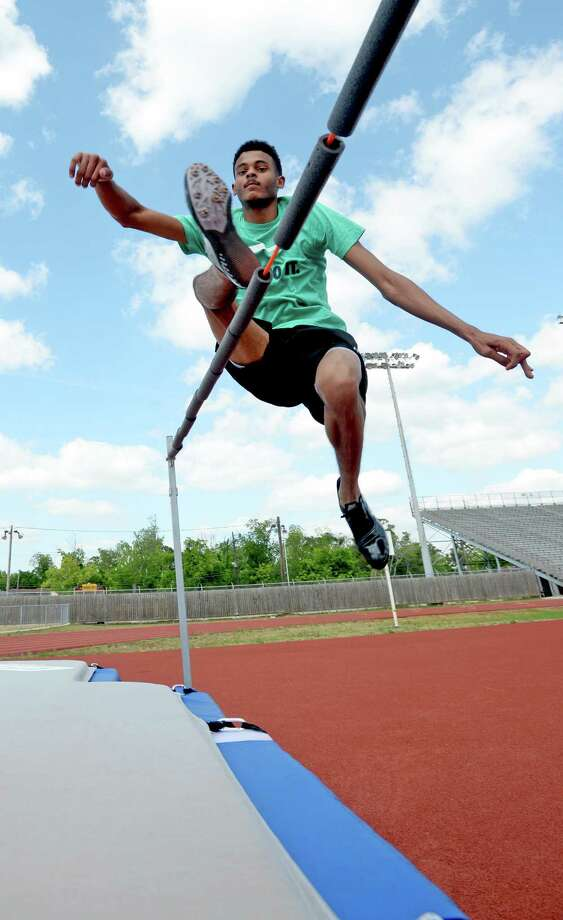 Andrew Wells practices the high jump at Jaguar Stadium on Tuesday. Only two months into field events, Wells will compete in Austin this weekend. Photo taken Tuesday, May 06, 2014 Guiseppe Barranco/@spotnewsshooter Photo: GUISEPPE          BARRANCO / B