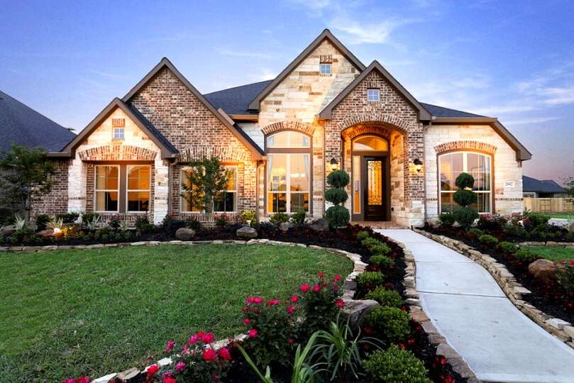... model home showcases a brick and stone front elevation, 2,860 square