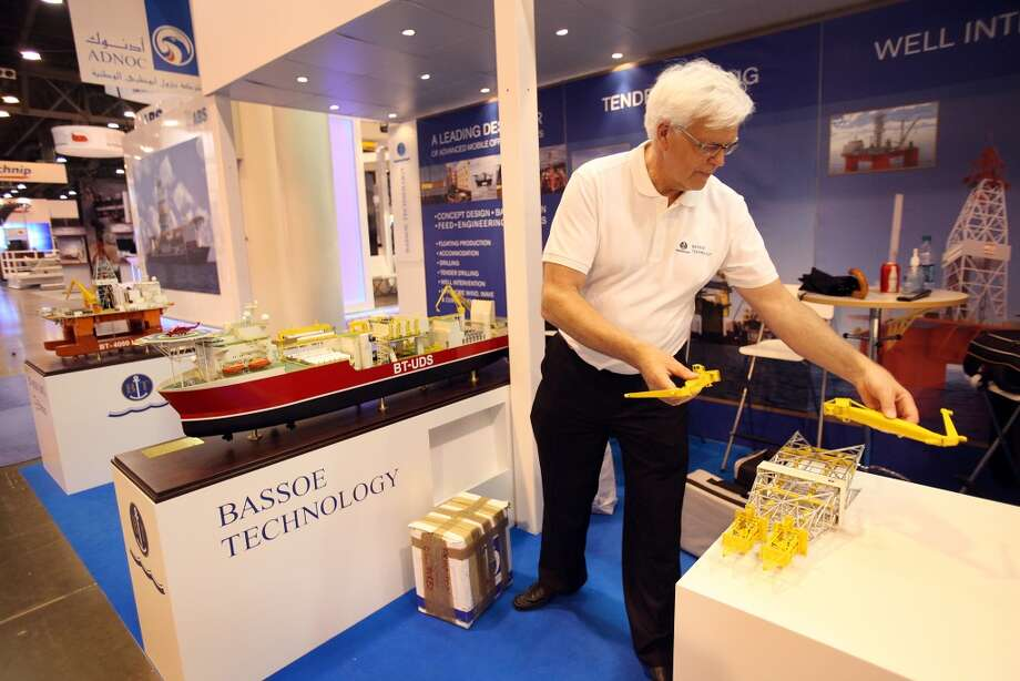Joakim Nilsson, of Bassoe Technology, breaks apart the model ships upon the conclusion of the Offshore Technology Conference at NRG on May 8, 2014, in Houston Tx. ( Mayra Beltran / Houston Chronicle ) Photo: Mayra Beltran, Houston Chronicle