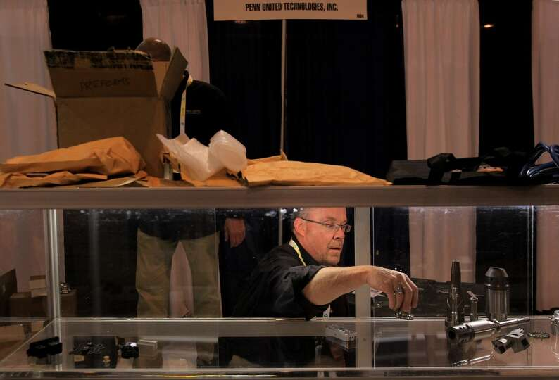 Mark Hunt, Penn United Techonologies, Inc., packs up equipment displayed in the company booth as tea