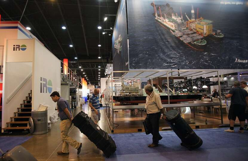 Exhibitors leave the work crews to tear down booths upon the conclusion of the Offshore Technology C