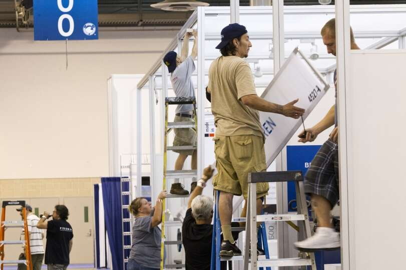 2014 Offshore Technology Conference exhibitors pack up during the final day of the conference, Thurs