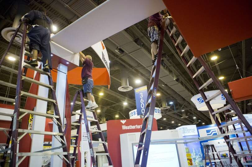 Exhibitors pack up their booths and displays on the final day of the 2014 Offshore Technology Confer