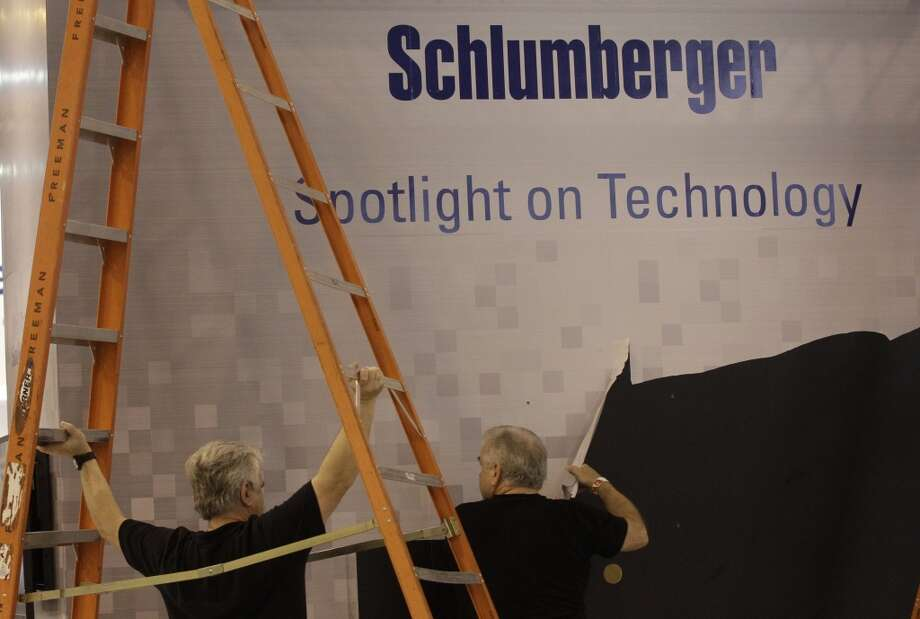 Work crews take down the Schlumberger booth at the conclusion of the Offshore Technology Conference at NRG Park on Thursday, May 8, 2014, in Houston.  ( J. Patric Schneider / For the Chronicle ) Photo: J. Patric Schneider, For The Chronicle