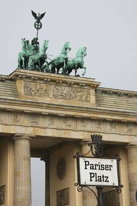 The celebrated Brandenburg Gate soars over Berlin's historic square, Pariser Platz.