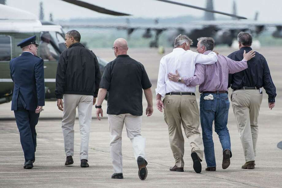 Arkansas  Governor Mike Beebe (3R), Rep. Tim Griffin (R-AR) and Senator Mark Pryor (R) D-AR follow as US President Barack Obama (2ndL) walks to Marine One at Little Rock Air Force Base May 7, 2014 in Arkansas. Obama will visit central Arkansas to survey rebuilding efforts and damage from last month's tornadoes while en route to California. AFP PHOTO/Brendan SMIALOWSKIBRENDAN SMIALOWSKI/AFP/Getty Images Photo: BRENDAN SMIALOWSKI / 2014 Brendan Smialowski
