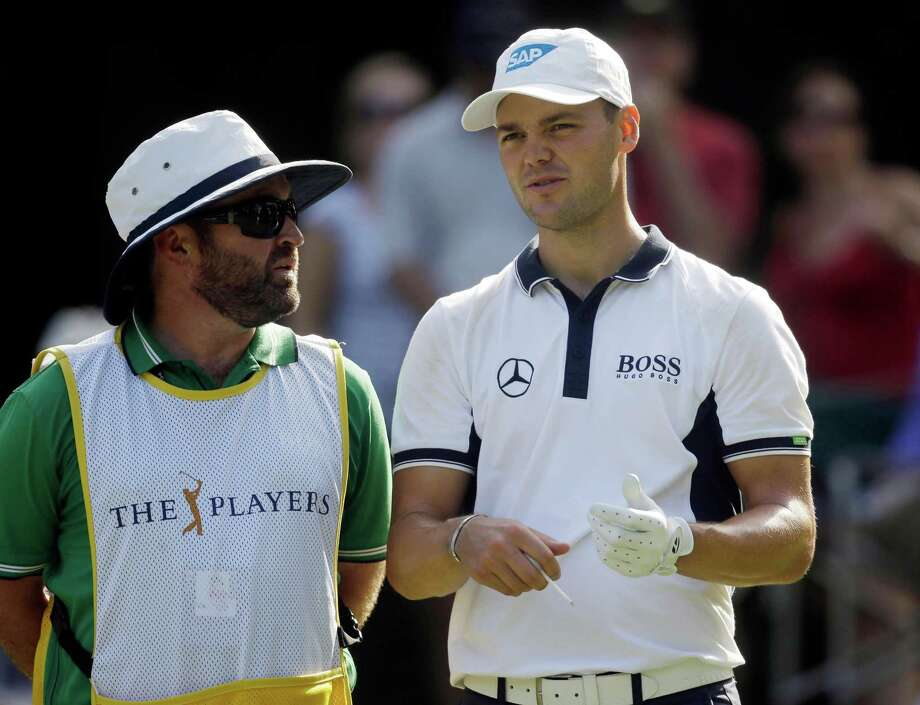 Martin Kaymer, right, of Germany, talks to his caddie Craig Connelly before hitting from the eighth tee during the first round of The Players championship golf tournament at TPC Sawgrass, Thursday, May 8, 2014 in Ponte Vedra Beach, Fla. (AP Photo/Gerald Herbert) ORG XMIT: XPVB145 Photo: Gerald Herbert / AP