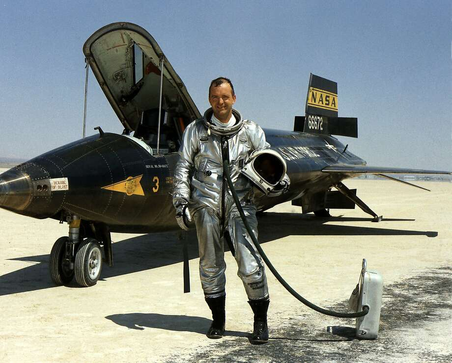 Research test pilot Bill Dana stands with the X-15 rocket plane in a lake bed at the Dryden Flight Research Center at Edwards Air Force Base in 1967. He also flew NASA's aircraft precursors to the space shuttle. Photo: Uncredited, Associated Press