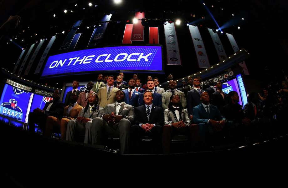 NEW YORK, NY - MAY 08:  NFL Commissioner Roger Goodell sits with draft prospects as they are introduced for the first round of the 2014 NFL Draft at Radio City Music Hall on May 8, 2014 in New York City. Photo: Elsa, Getty Images / 2014 Getty Images