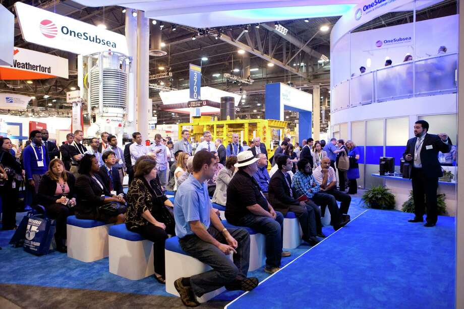 A record 108,300 people attended the OTC this year, and some were still around for a presentation at the OneSubsea booth as the conference wound down Thursday. ( Marie D. De Jesus / Houston Chronicle ) Photo: Marie D. De Jesus, Staff / © 2014 Houston Chronicle