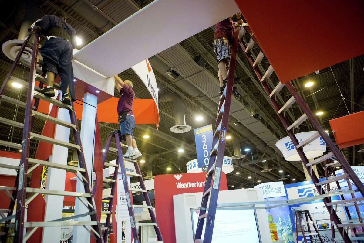 Exhibitors pack up their booths and displays Thursday on the final day of the 2014 Offshore Technology Conference. ( Marie D. De Jesus / Houston Chronicle )