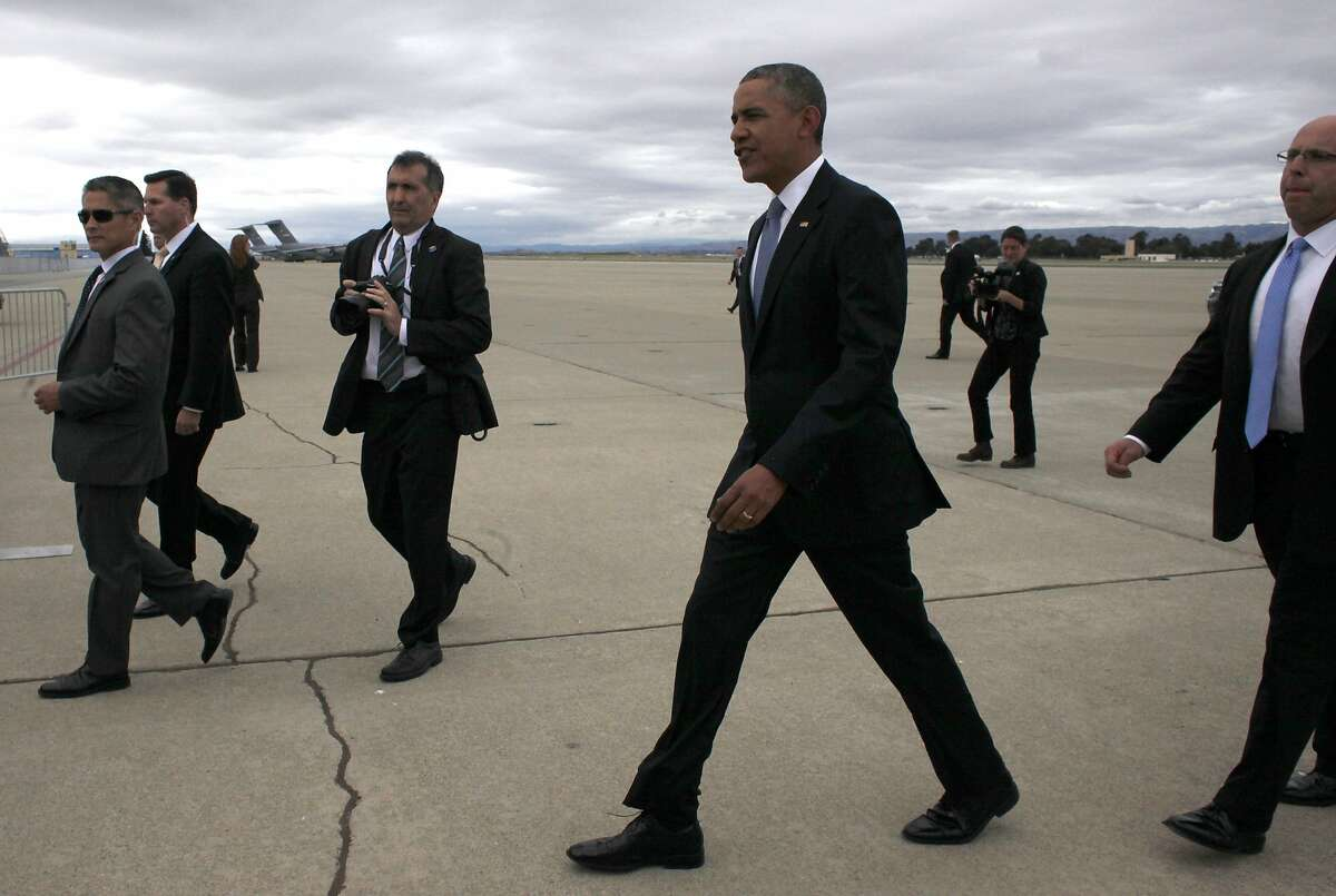 President Obama walks to the crowd of supporters after he arrives at Moffett Field, Thursday May 8, 2014 in Mountain View, Calif.