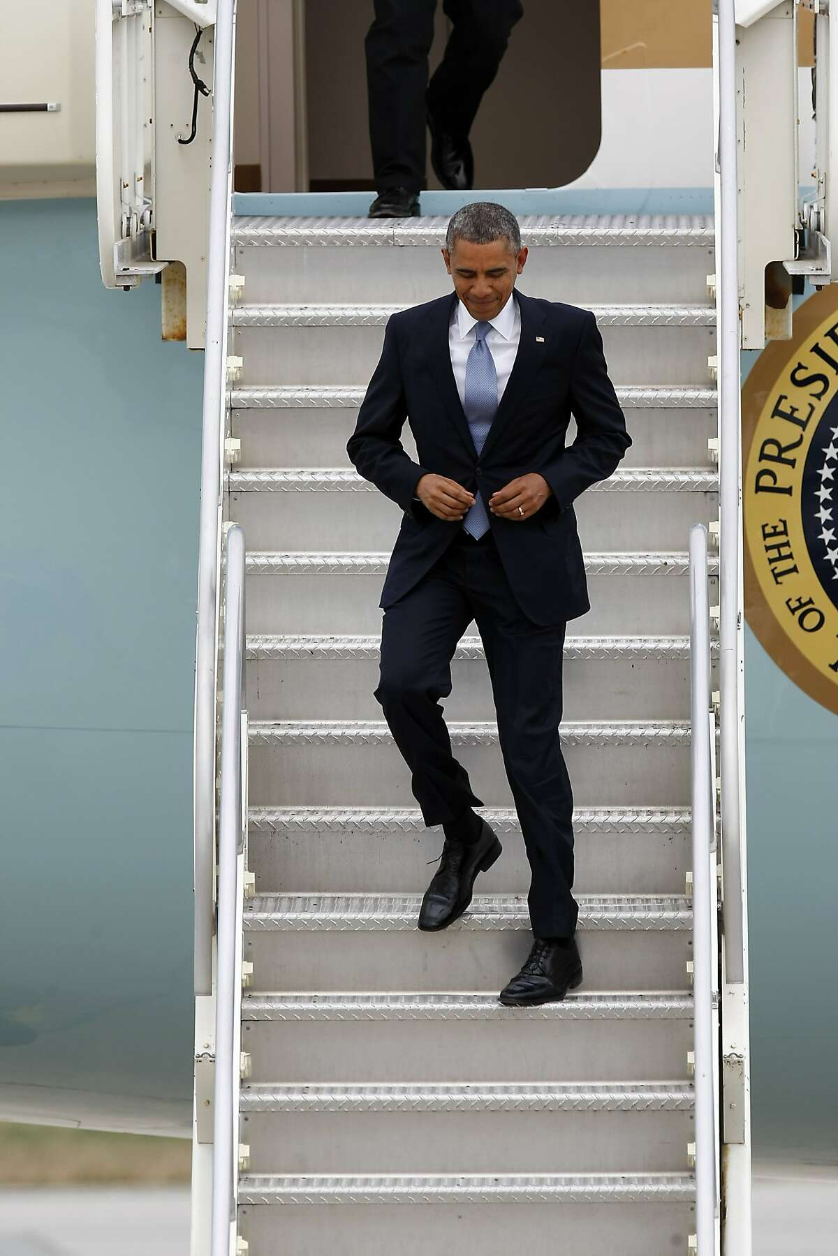 US President Barack Obama disembarks from Air Force One upon arrival at Moffett Federal Airfield in Mountain View, CA, Thursday May 8, 2014. President Obama is in the South Bay for a DNC roundtable and reception and is also speaking on the topic of energy efficiency at a local Walmart.
