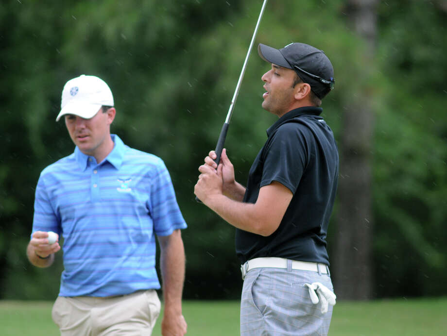Kyle Nathan, right, anguishes over a missed putt on the 14th hole as playing partner and eventual winner Matt Van Zandt prepares to putt. Photo: Jerry Baker, Freelance