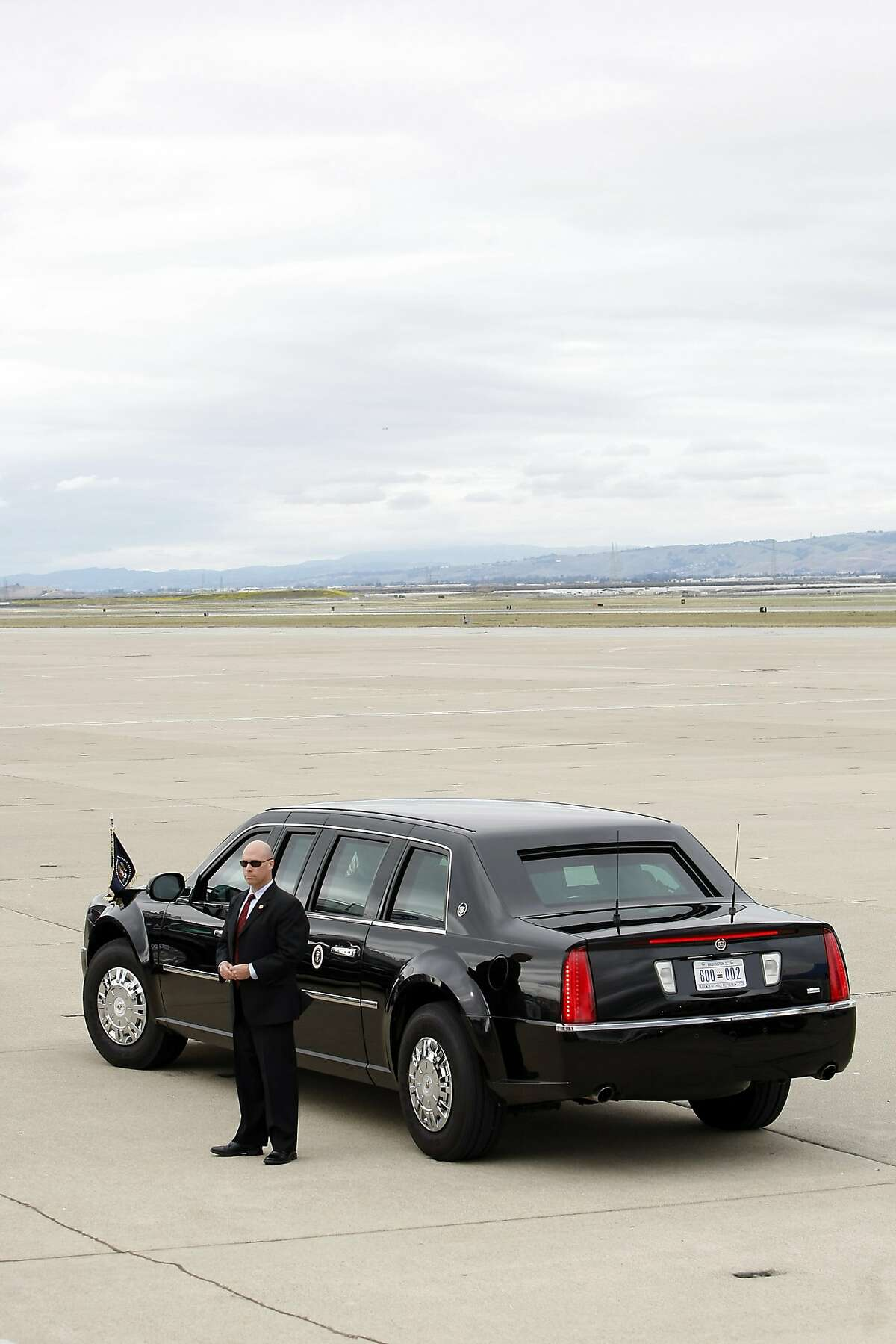 US President Barack Obama's limousine sits on the tarmac after his arrival at Moffett Federal Airfield in Mountain View, CA, Thursday May 8, 2014. President Obama is in the South Bay for a DNC roundtable and reception and is also speaking on the topic of energy efficiency at a local Walmart.