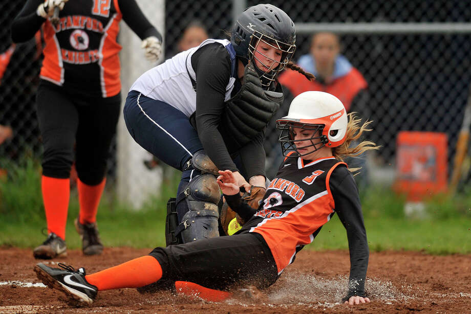 Stamford's Kyra Yacavone is tagged out at home by Staples' catcher Emma Moskovitz during their softball game at Bedford Middle School in Westport, Conn., on Thursday, May 8, 2014. Stamford won, 10-1 Photo: Jason Rearick / Stamford Advocate
