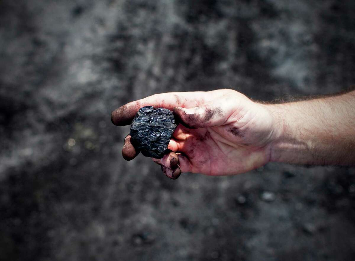Coal from an open-pit strip mine run by Western Kentucky Minerals near Owensboro, Ky., Aug. 1, 2012. A strip mine proposed by the company could soon abut Camp Pennyroyal, a Girl Scout camp, altering its vista for at least a decade. (Ben Sklar/The New York Times)