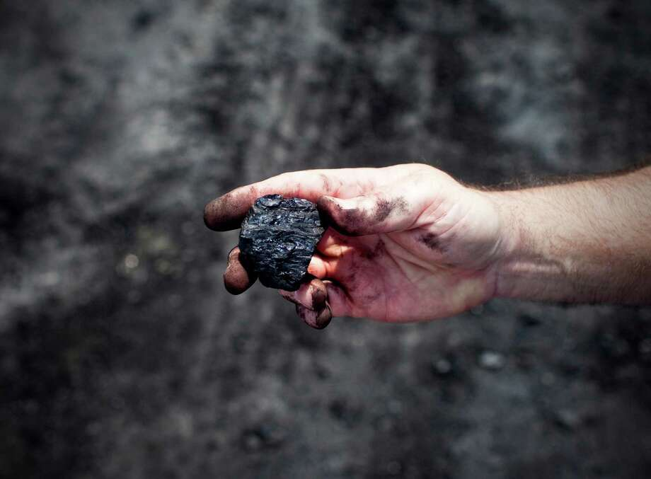 Coal from an open-pit strip mine run by Western Kentucky Minerals near Owensboro, Ky., Aug. 1, 2012. A strip mine proposed by the company could soon abut Camp Pennyroyal, a Girl Scout camp, altering its vista for at least a decade. (Ben Sklar/The New York Times) Photo: BEN SKLAR / Benjamin Sklar
