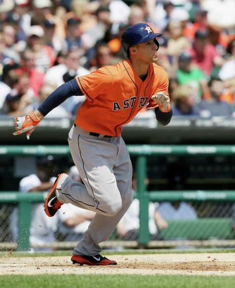 George Springer watches the first home run of his major league career zoom over the right-field fence in Thursday's fifth inning at Detroit's Comerica Park. Photo: Carlos Osorio, STF / AP