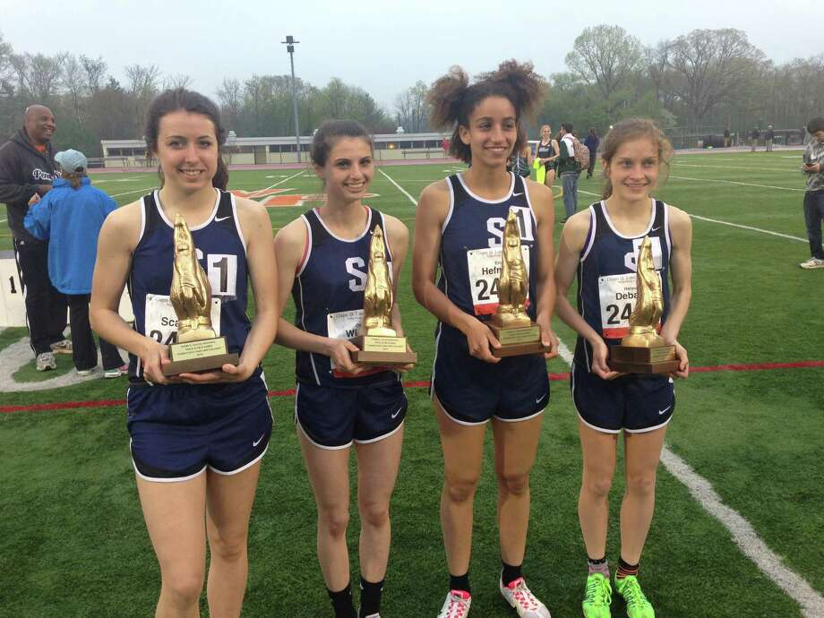 From left: Tyler Scanlin, Olivia Wiener, Erica Hefnawy and and Hannah DeBalsi hold their trophies from winning the DMR event at the Loucks Games on Thursday. Photo: Ryan Lacey/Staff Photo / Westport News Contributed