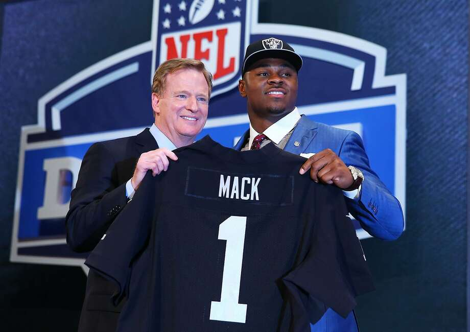 NEW YORK, NY - MAY 08:  Khalil Mack of the Buffalo Bulls poses with NFL Commissioner Roger Goodell after he was picked #5 overall by the Oakland Raiders during the first round of the 2014 NFL Draft at Radio City Music Hall on May 8, 2014 in New York City.  (Photo by Elsa/Getty Images) Photo: Elsa, Getty Images