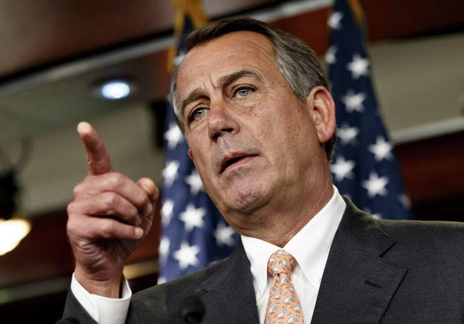 """Speaker of the House John Boehner is asked about the special select committee he has formed to investigate the deadly 2012 attack on the U.S. diplomatic post in Benghazi, Libya, raising the stakes in a political battle with the Obama administration as the midterm election season heats up, during a news conference on Capitol Hill in Washington, Thursday, May 8, 2014. The National Republican Congressional Committee has issued a fundraising pitch on its website asking people to become a """"Benghazi Watchdog"""" by donating money to GOP election efforts. Boehner has said that the examination would be """"all about getting to the truth"""" of the Obama administration's response to the attack and would not be a partisan, election-year circus. (AP Photo/J. Scott Applewhite) Photo: J. Scott Applewhite, STF / AP"""