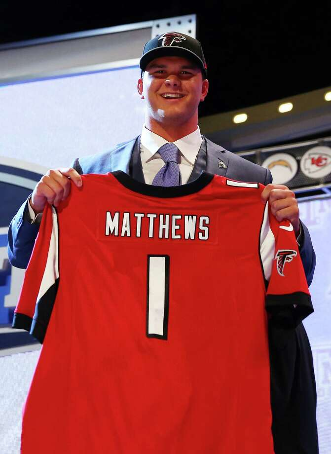 NEW YORK, NY - MAY 08:  Jake Matthews of the Texas A&M Aggies poses with a jersey after he was picked #6 overall by the Atlanta Falcons during the first round of the 2014 NFL Draft at Radio City Music Hall on May 8, 2014 in New York City. Photo: Elsa, Getty Images / 2014 Getty Images