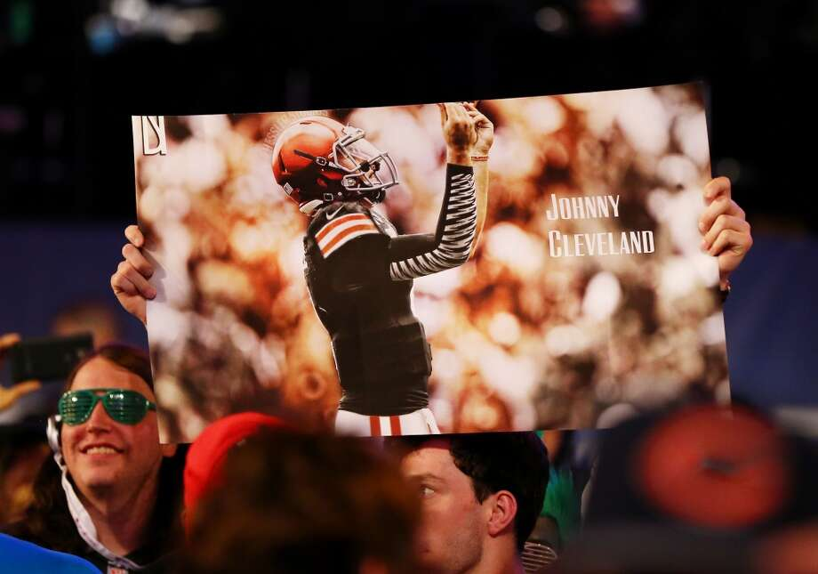 "Fans hold up a sign reading ""Johnny Cleveland"" as Johnny Manziel of the Texas A&M Aggies is picked #22 overall by the Cleveland Browns during the first round of the 2014 NFL Draft at Radio City Music Hall on May 8, 2014 in New York City. Photo: Elsa, Getty Images"