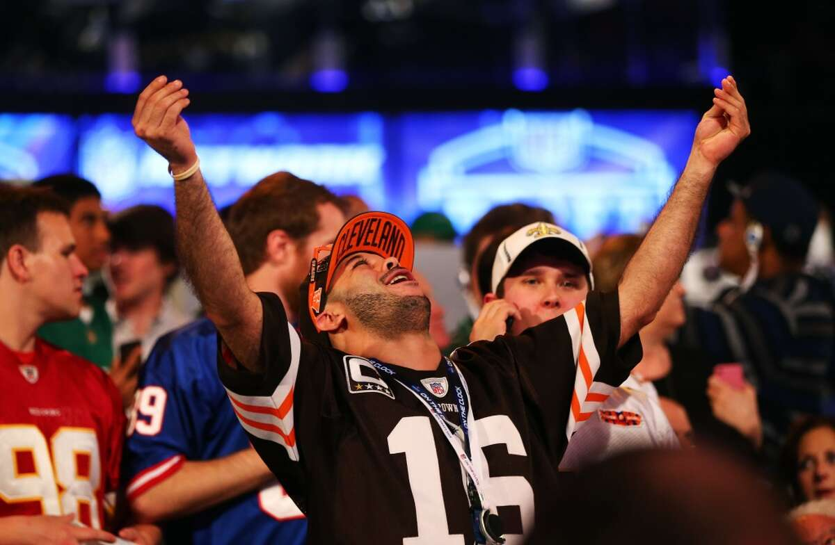 A fan reacts as Johnny Manziel of the Texas A&M Aggies is picked #22 overall by the Cleveland Browns during the first round of the 2014 NFL Draft at Radio City Music Hall on May 8, 2014 in New York City.